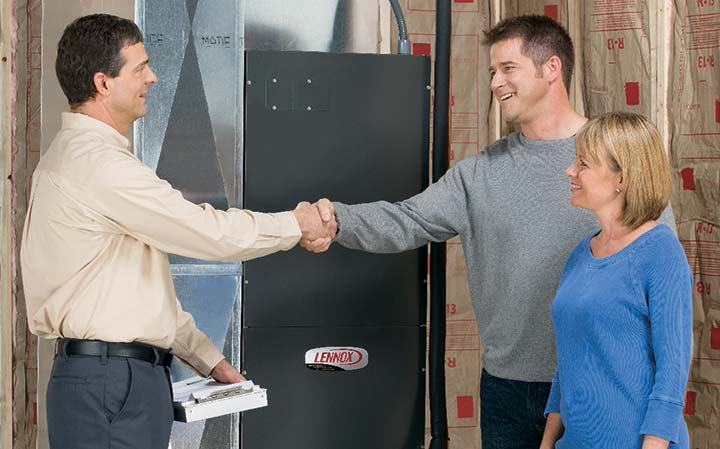 sales person shaking hands with clients